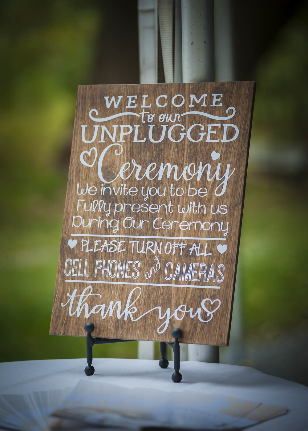 In addition to a brief statement by your wedding officiant, don't hesitate to have a sign as people enter the site advising you're having an unplugged wedding ceremony.