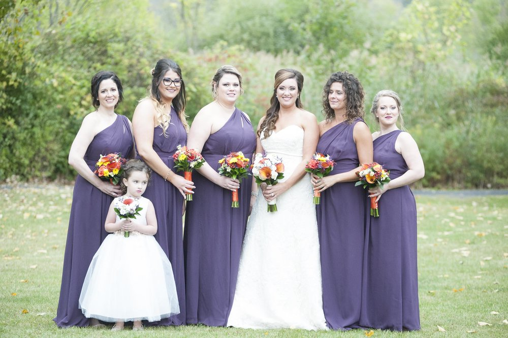 As you can see in this photo, the bridesmaid 2nd from the right, is looking in the wrong direction and it's difficult to tell whether her eyes are open or closed; therefore, this image was discarded.