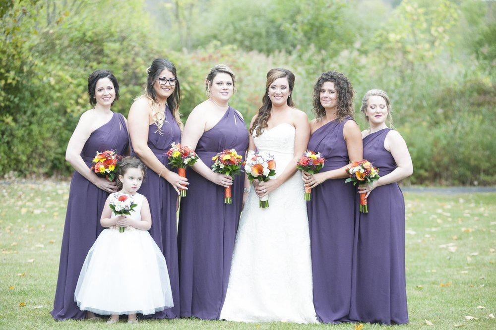 In this image, the bridesmaid all the way to the right closed her eyes.