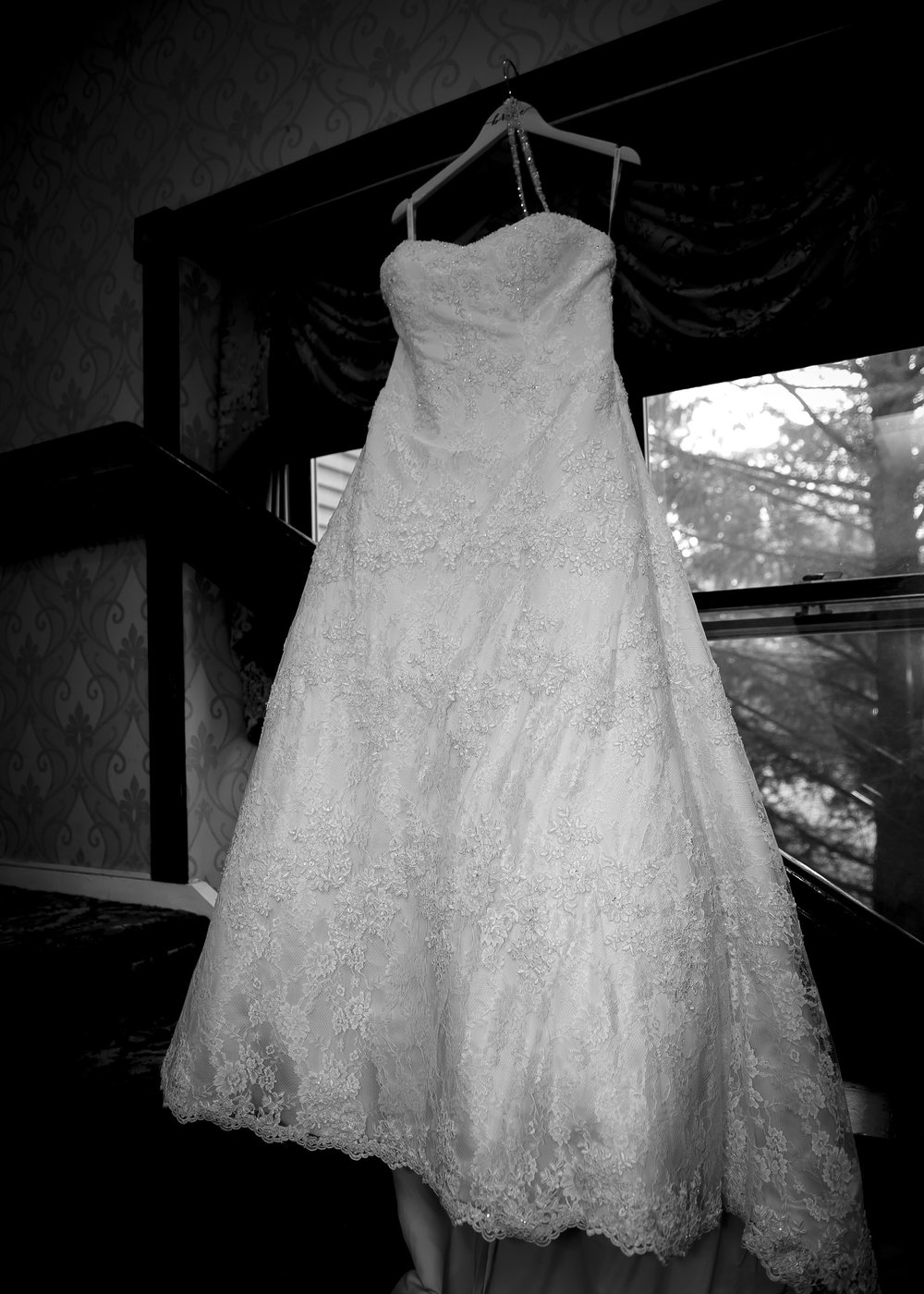 I love how this black and white image highlights the exquisite details of this beautiful wedding dress!