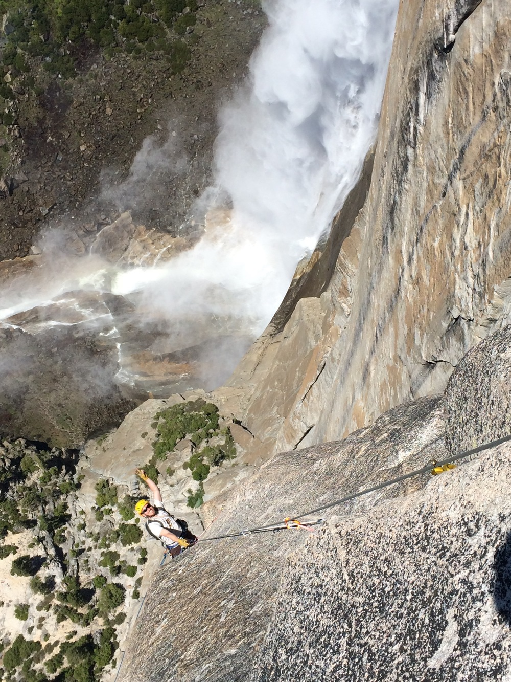 Jugging the last pitch, with Yosemite Falls in the background.