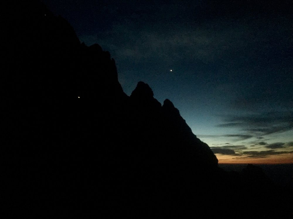 First light! We started up the Grand at 1AM from the Climbers Ranch in order to give us the best shot at summiting for totality. The light in the sky is Venus, and headlamps are visible heading up the Grand.