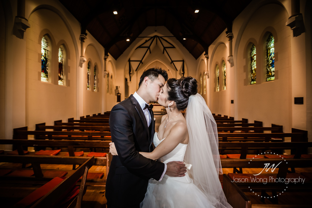 a-kiss-in-a-church-bride-and-groom.jpg