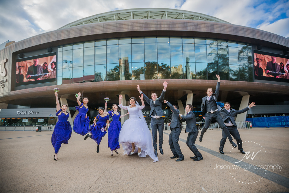 adelaide-oval-bridal-party-jump-happy.jpg