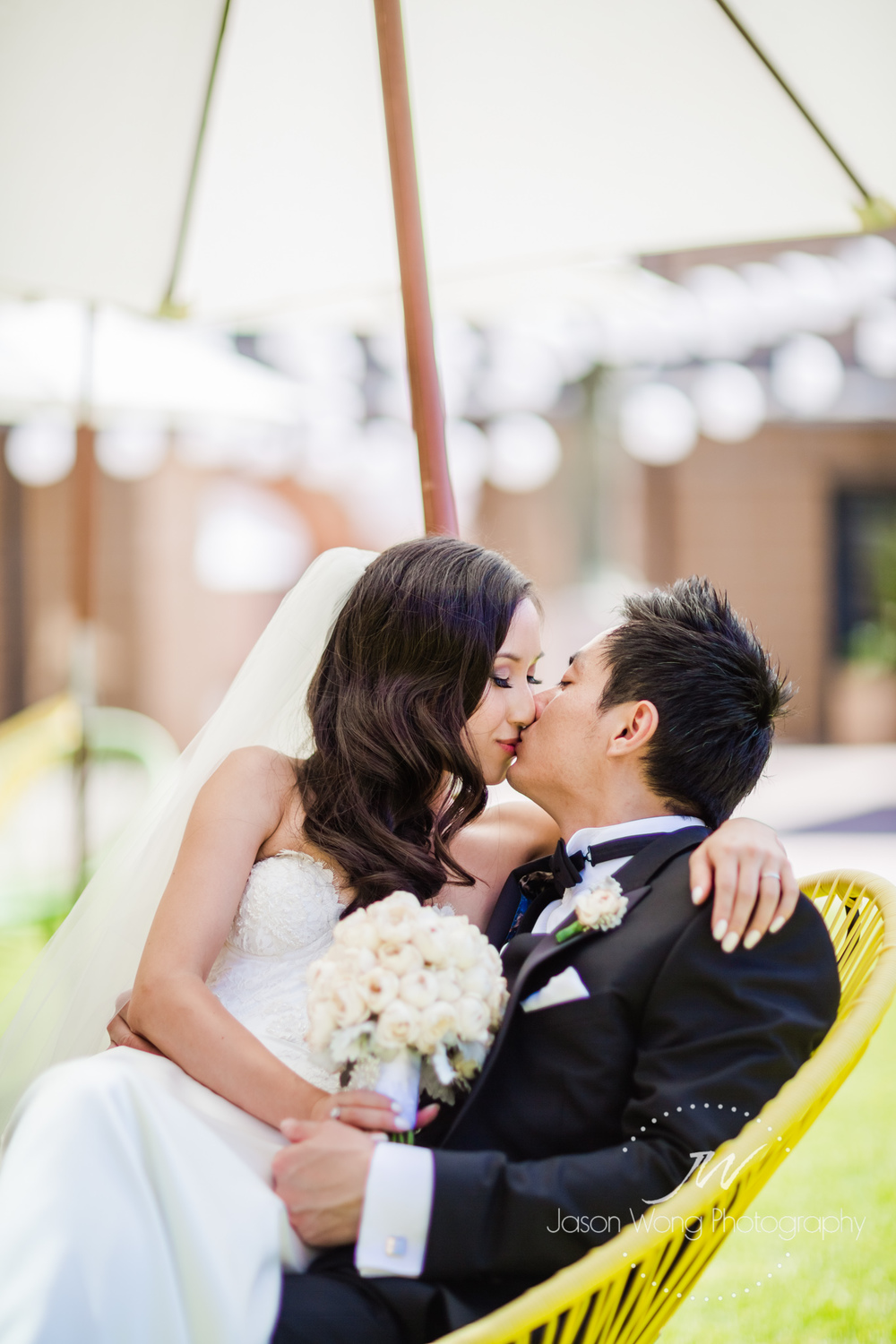 chilling-and-romantic-kiss-of-newlyweds.jpg