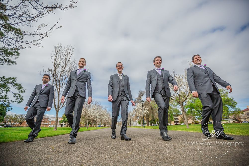 groom-and-groomsmen-walk-in-garden.jpg