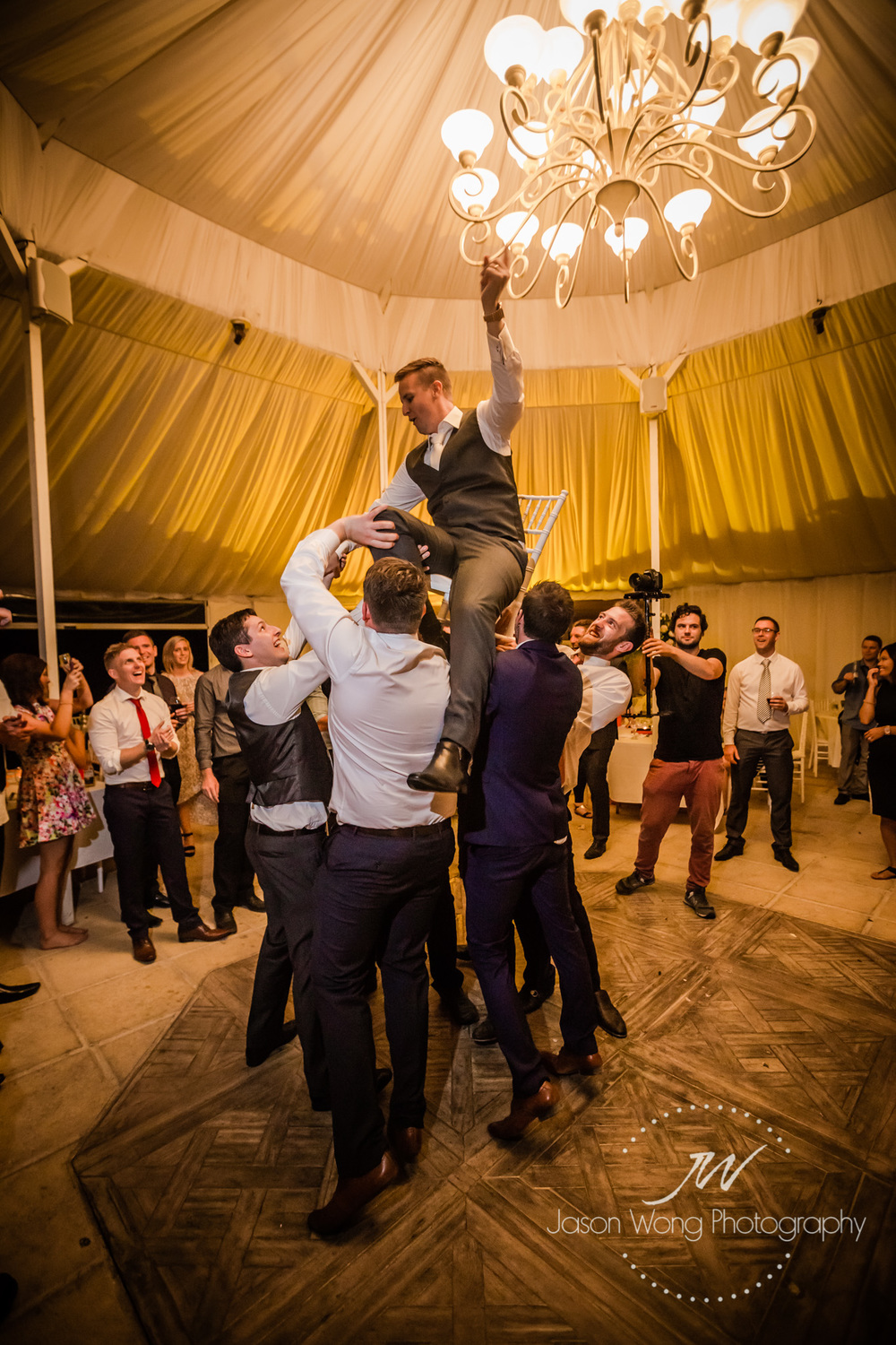 groom-having-fun-getting-toss.jpg