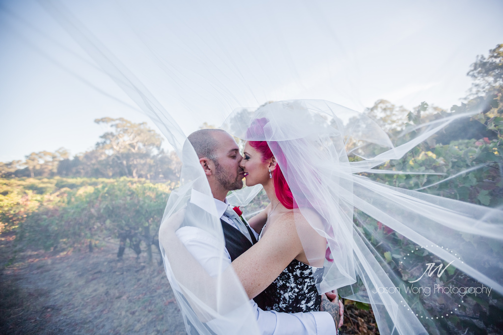 kiss-inside-veil-jason-wong-photography-style.jpg