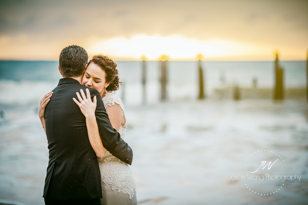 romantic-bride-and-groom-hug-at-port-willunga-sunset.jpg