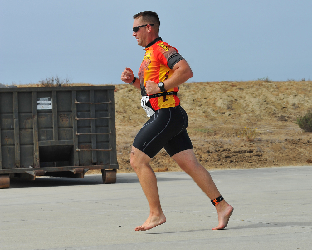 """BAREFOOT MARINE"" -- THE ONLY BAREFOOT RUNNER IN A TRIATHLON.  PHOTO BY  CHRIS HUNKELER  USED UNDER  LICENSE"