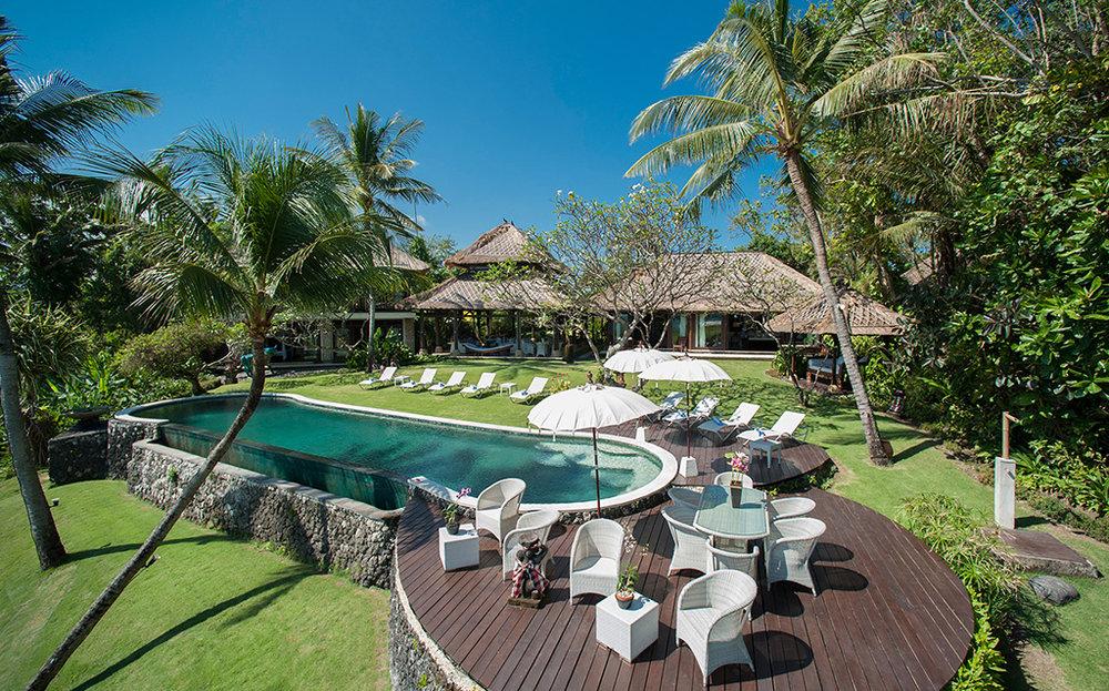 Sungai-Tinggi-Beach-Villa-Poolside-seating.jpg