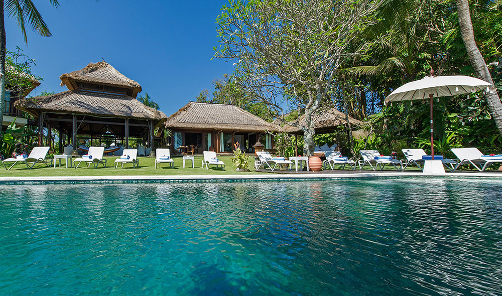 Sungai-Tinggi-Beach-Villa-Sun-loungers-line-the-pool.jpg