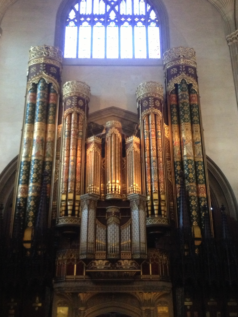 The highly decorated façade of the organ at Eton College Chapel