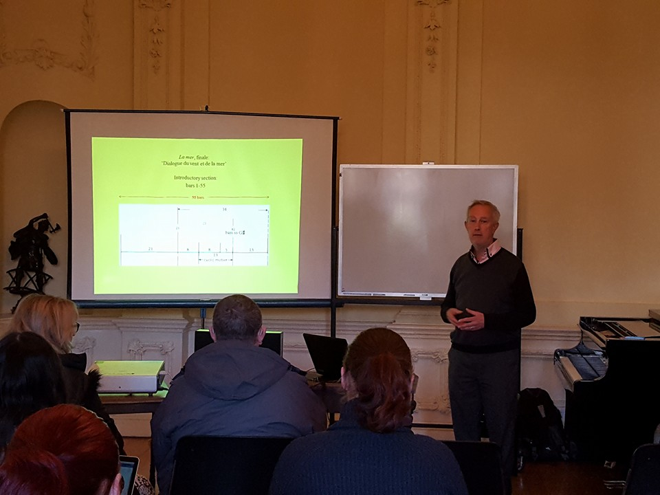 Dr Roy Howat lecturing several enthusiastic music nerds. That's the back of my head right there, in the blue. No not the blue jacket. Come on people be serious. Image courtesy of Melbourne Music Analysis Summer School Facebook page.
