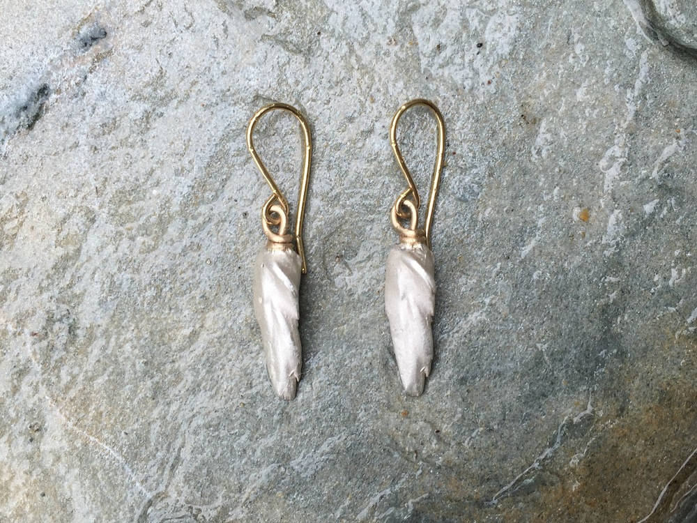 single feather mississippi wing drop earrings