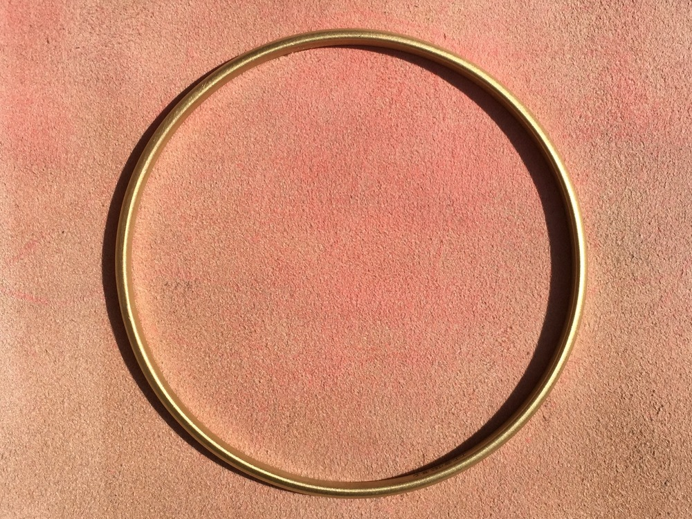 Solid gold signature bangle