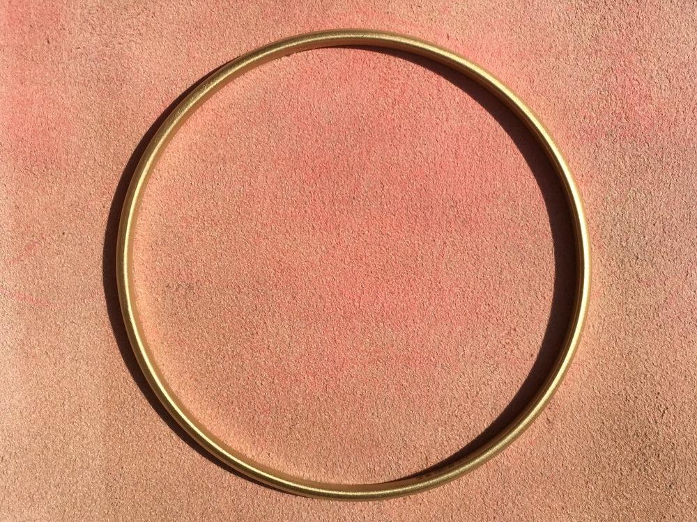 Solid gold signature bangle