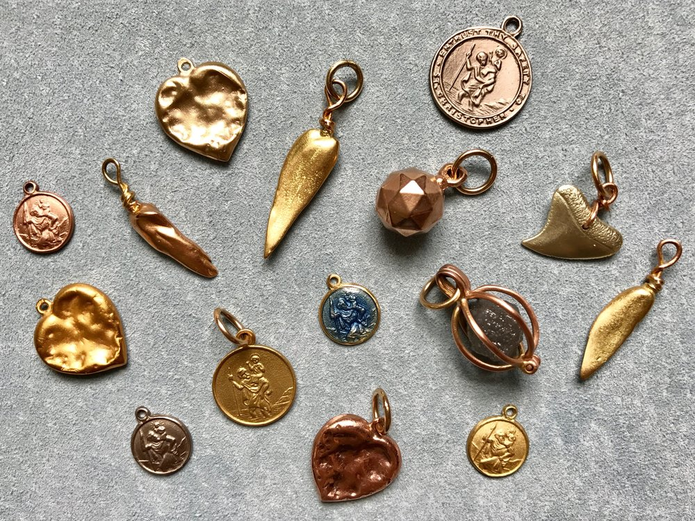 COLLECTION OF CHARMS & PENDANTS