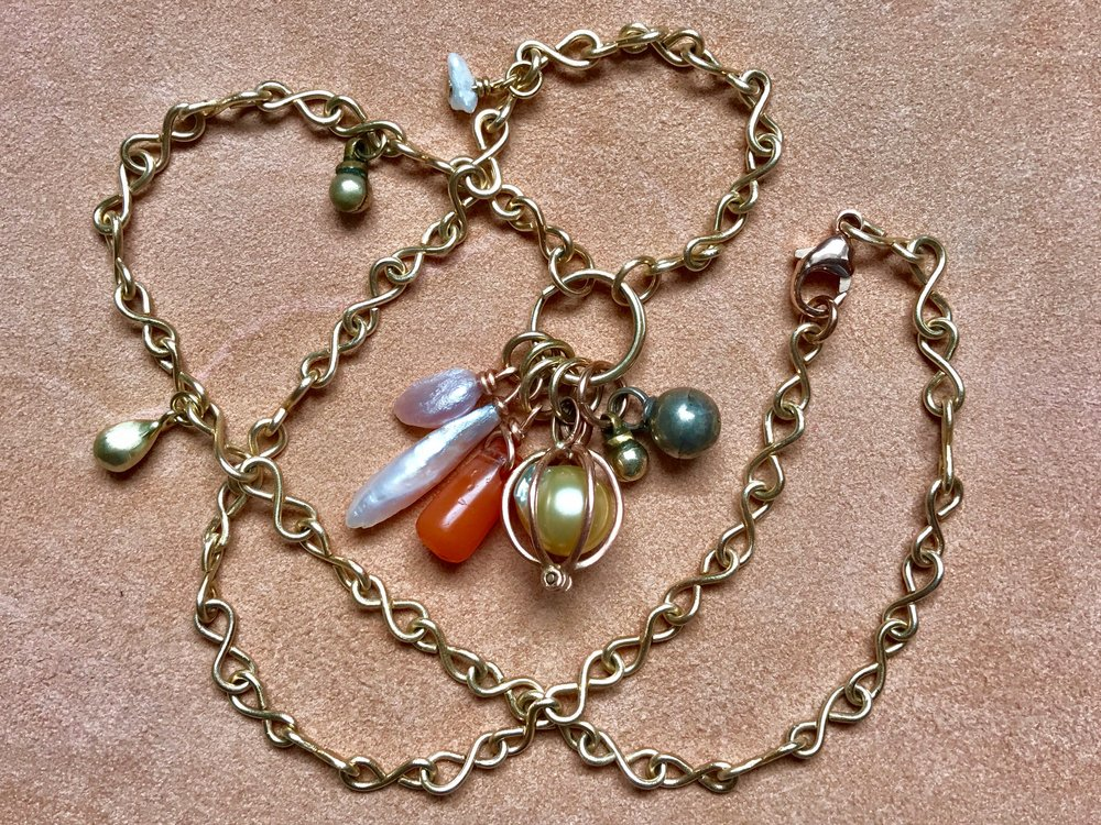 INFINITY CHAIN WITH MISSISSIPPI PEARL, CARNELIAN, SOUTH SEA PEARL, BEDOUIN BELL PENDANT NECKLACE