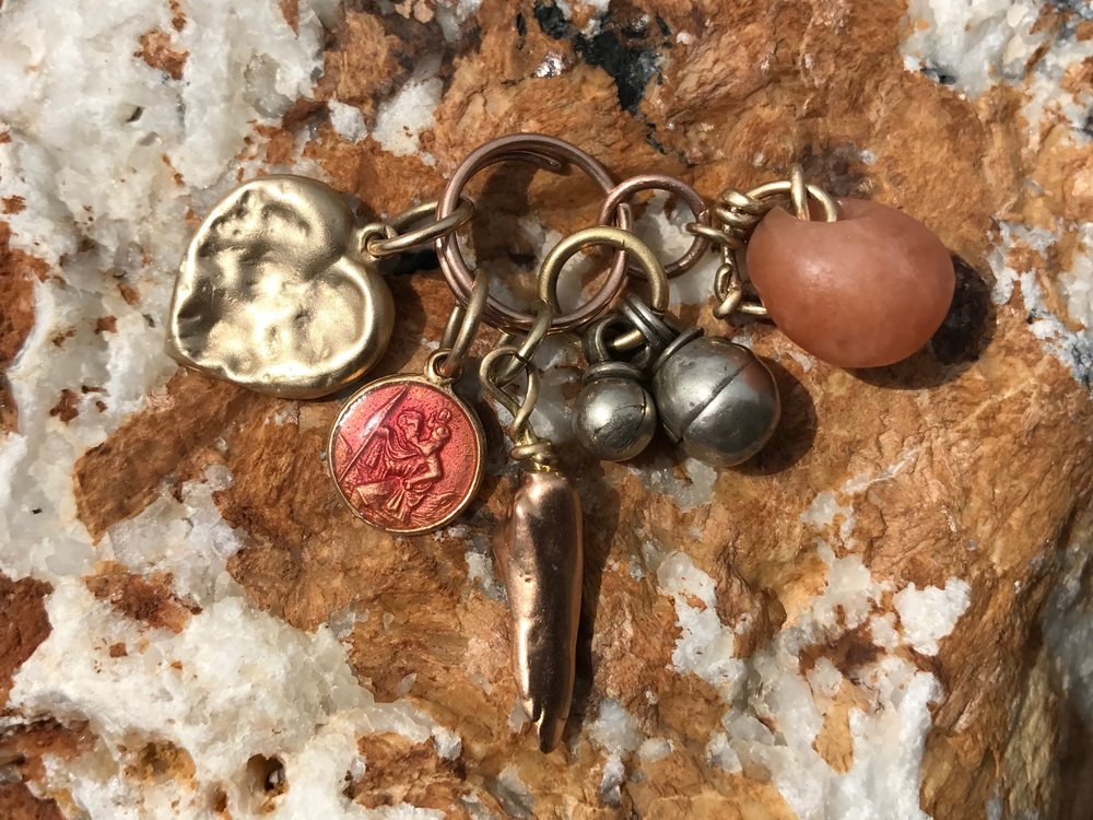 YELLOW GOLD CHEWED HEART, PINK ENAMEL ST. CHRISTOPHER, MISSISSIPPI PEARL CAST, BEDOUIN BELLS & CARNELIAN BEAD PENDANT