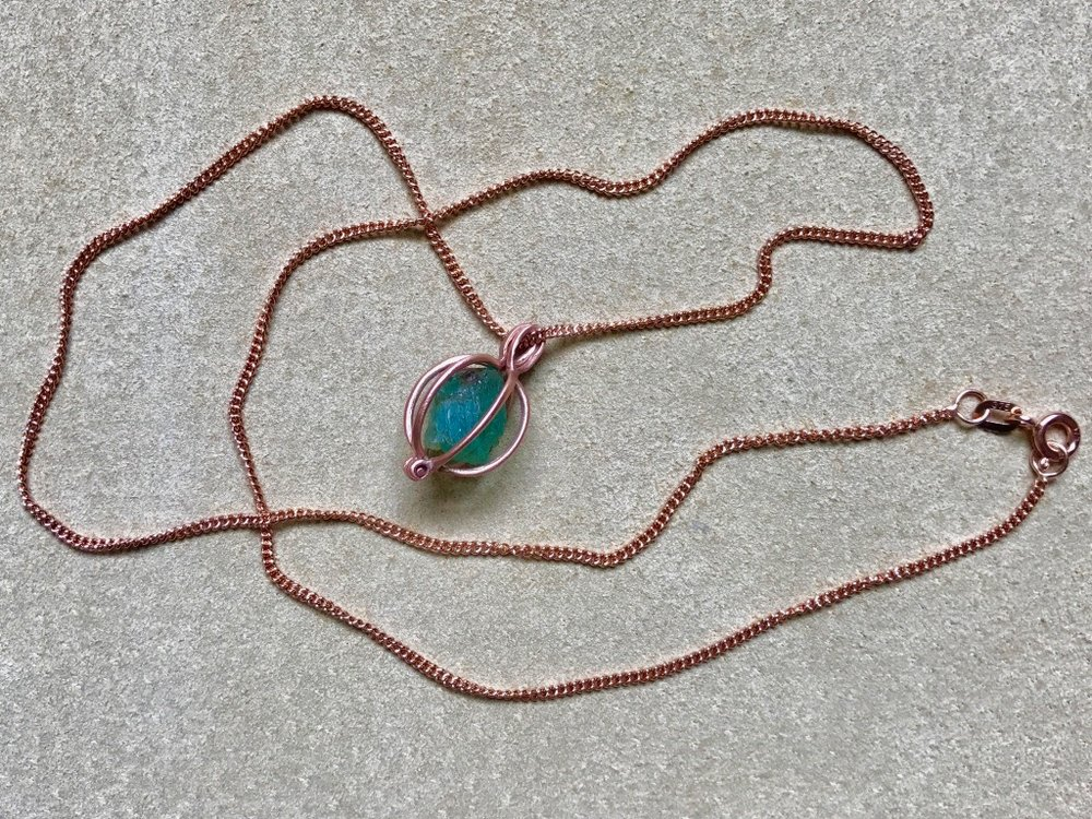 EMERALD GEM BASKET ON ROSE GOLD CURB CHAIN