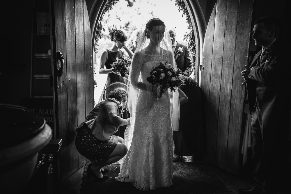 Bride arriving at Church in the Worcestershire village of Harvington.