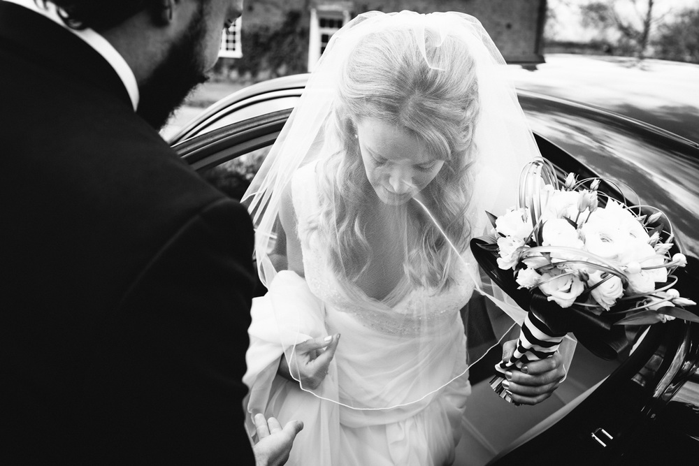 Bride arriving at church in Warwickshire.