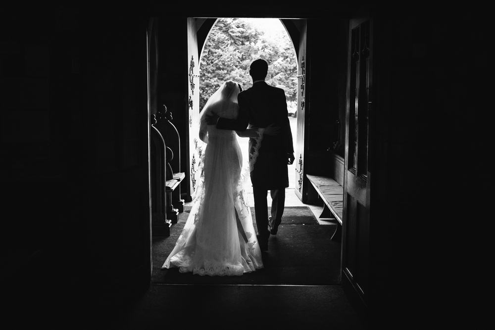 Alice and Wes leaving Church following their Staffordshire Rodbaston Hall Wedding.