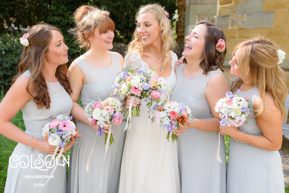 Bridesmaids laughing at Leicestershire Wedding.