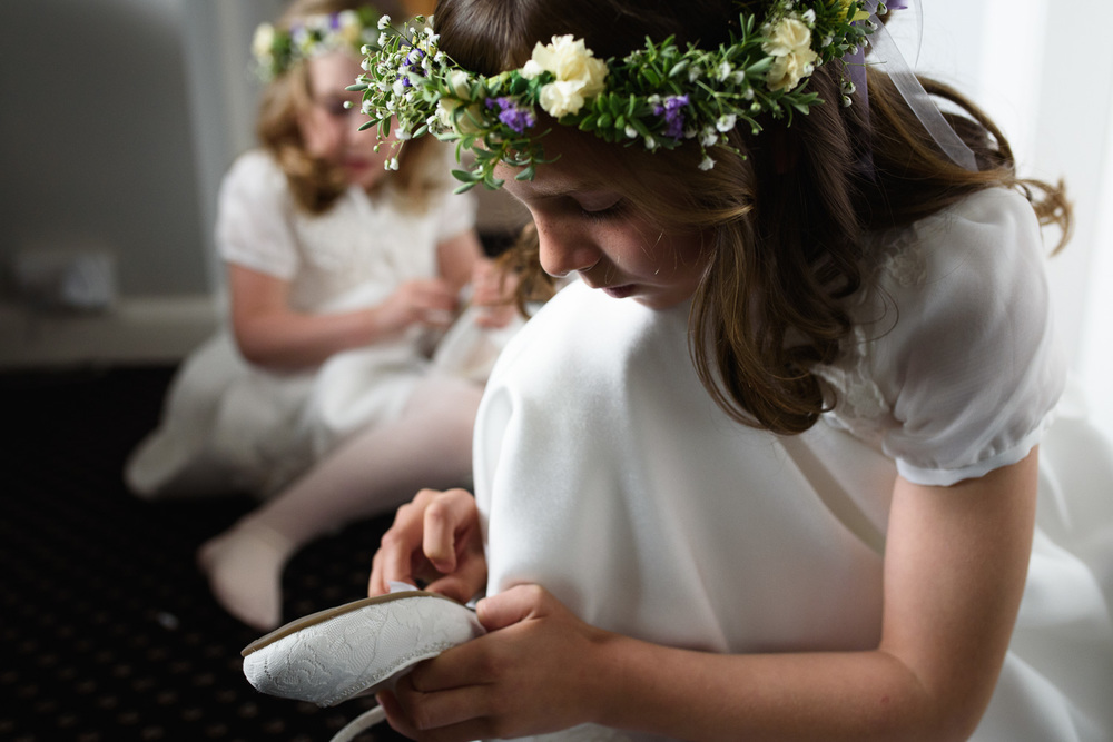 A beautiful picture of flowergirls preparing for a wedding.