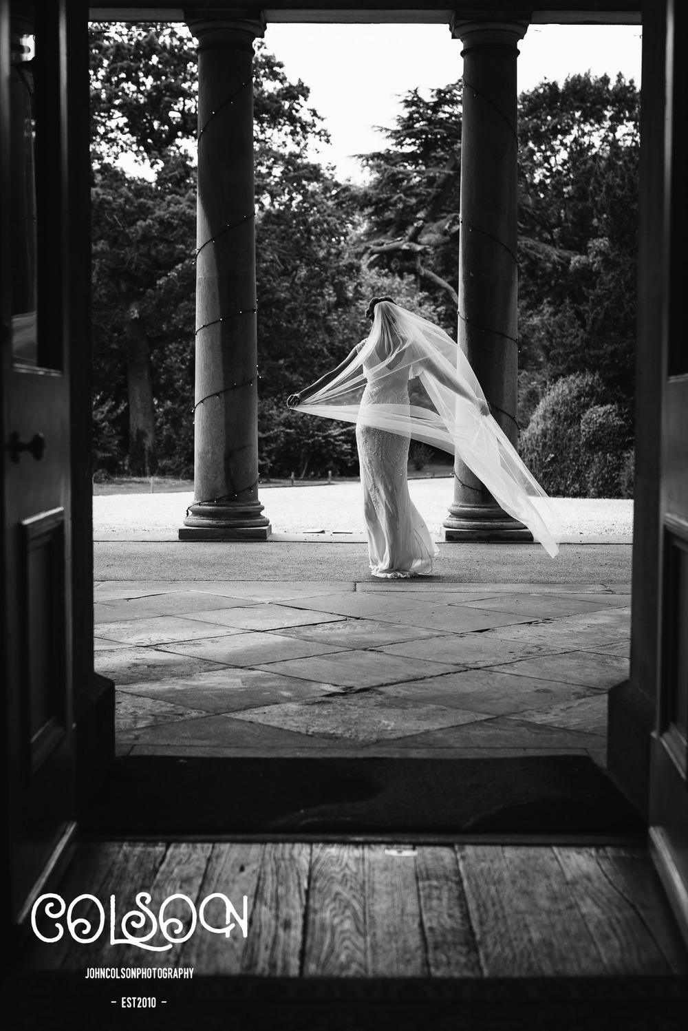 A beautiful bride at Prestwold Hall photographed by John Colson.
