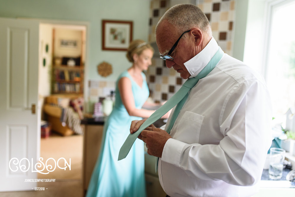 Laura's dad in deep concentration whilst tying his tie. I know the feeling well.....