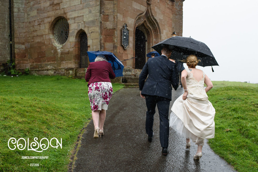 It poured down for most of the day at Alexis and Darren's wedding however it did make for some fun photographs, and I didn't get soaked either!