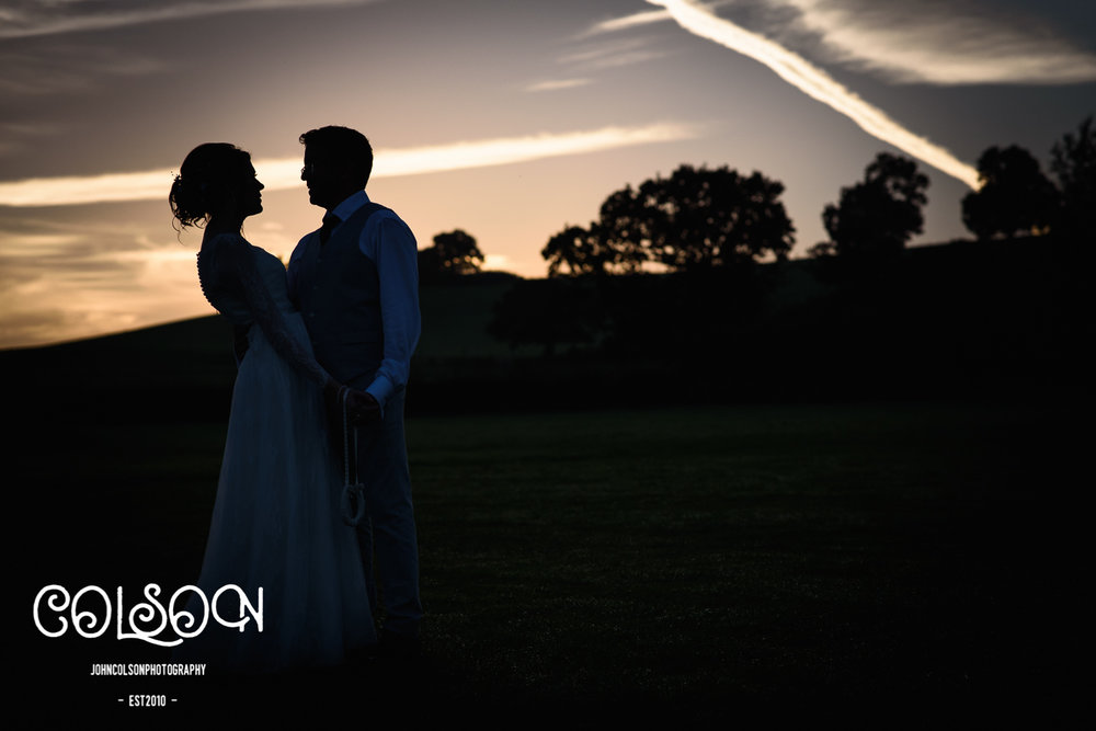 A beautiful sunset for Liz and Rup's wedding at Alcott Farm, Worcestershire.