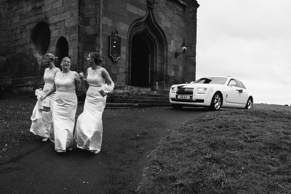 Bridesmaids at a rainy wedding in Worcestershire.