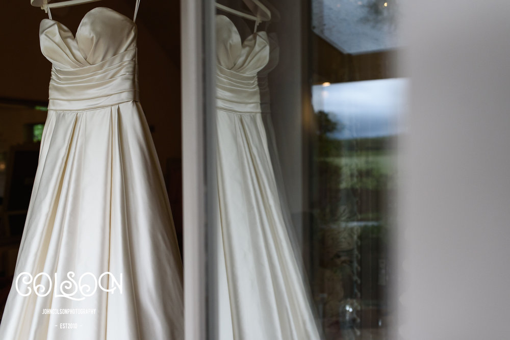 Rachels beautiful Wedding Dress hanging in the door way of the 'Hen House' at Lemore Manor.