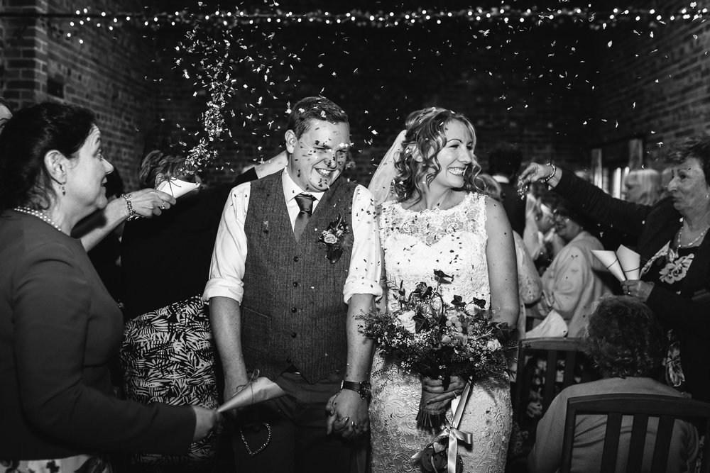 Curradine Barns is one of the few venues that allows guests to throw Confetti indoors, which makes it spontaneous... and therefore fantastic for me!
