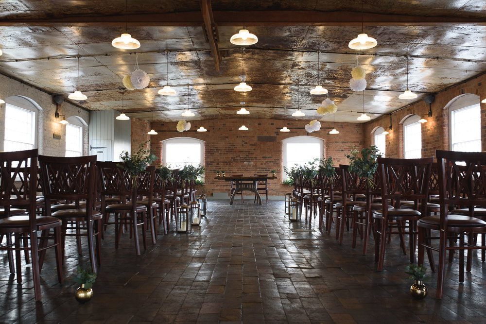 The upper floor of The West Mill is set out for Wedding Ceremonies. With plenty of space for a large number of guests, together with lovely light and that ceiling... it is a gorgeous space.