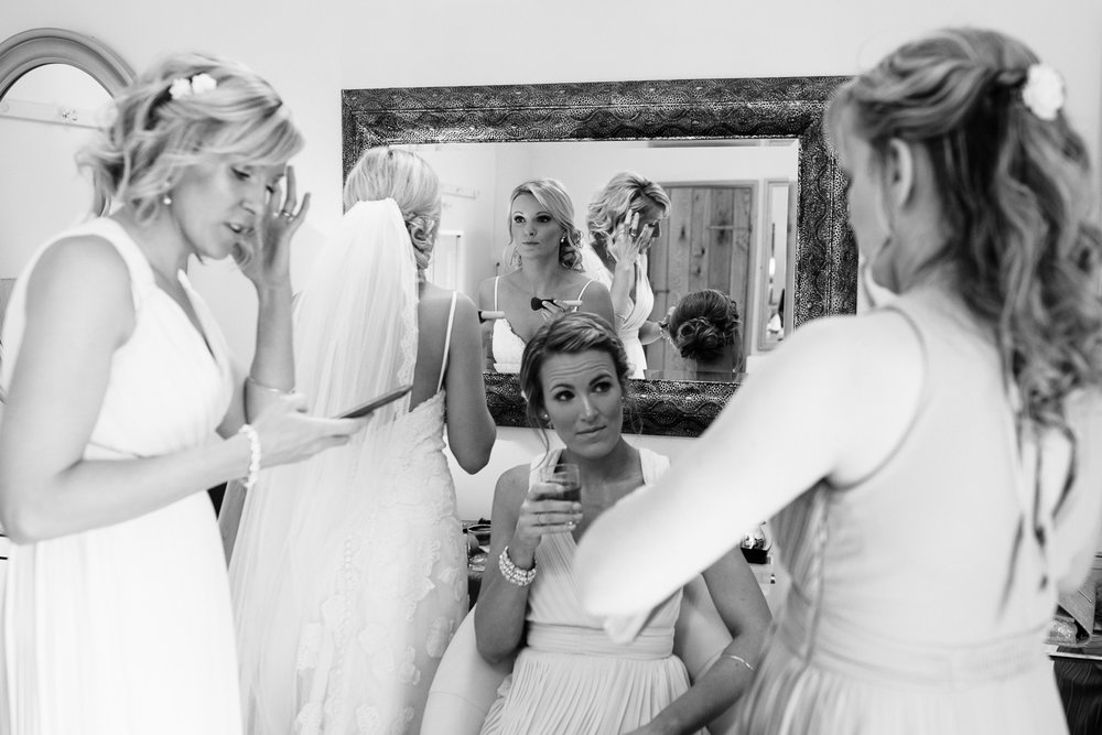 Last minute texts, wine and make up at Alice and Robs Herefordshire Wedding.
