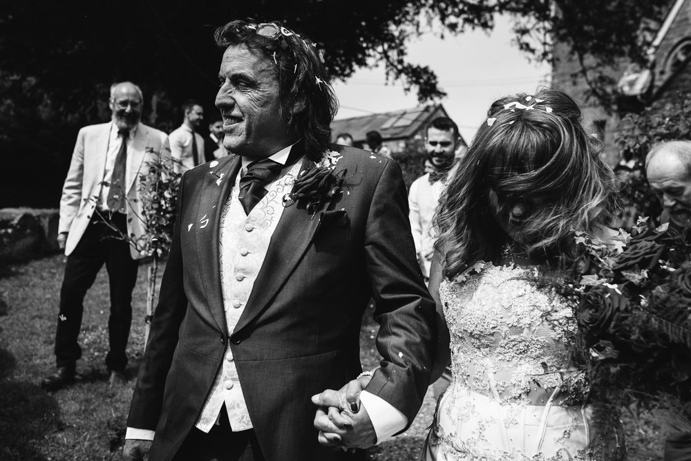 Throwing Confetti at a wedding in Herefordshire.