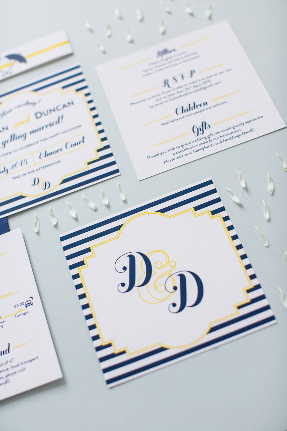 Dylan and Duncan's yellow and blue bespoke stationery for their Elmore Court wedding
