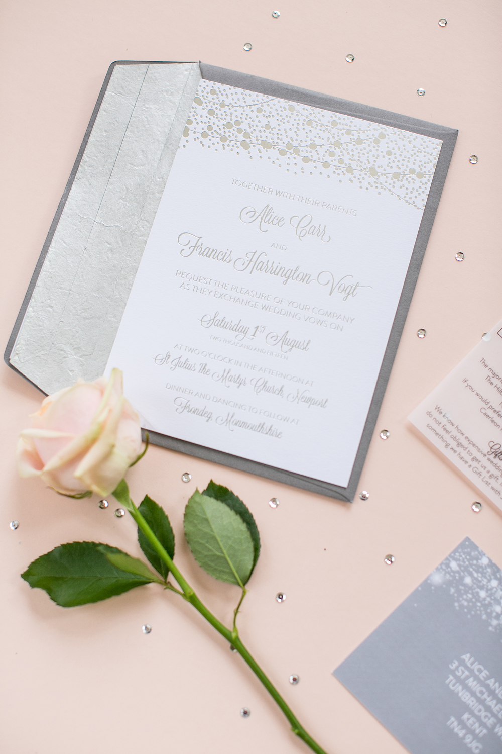 Alice and Francis' silver foiled wedding invitation