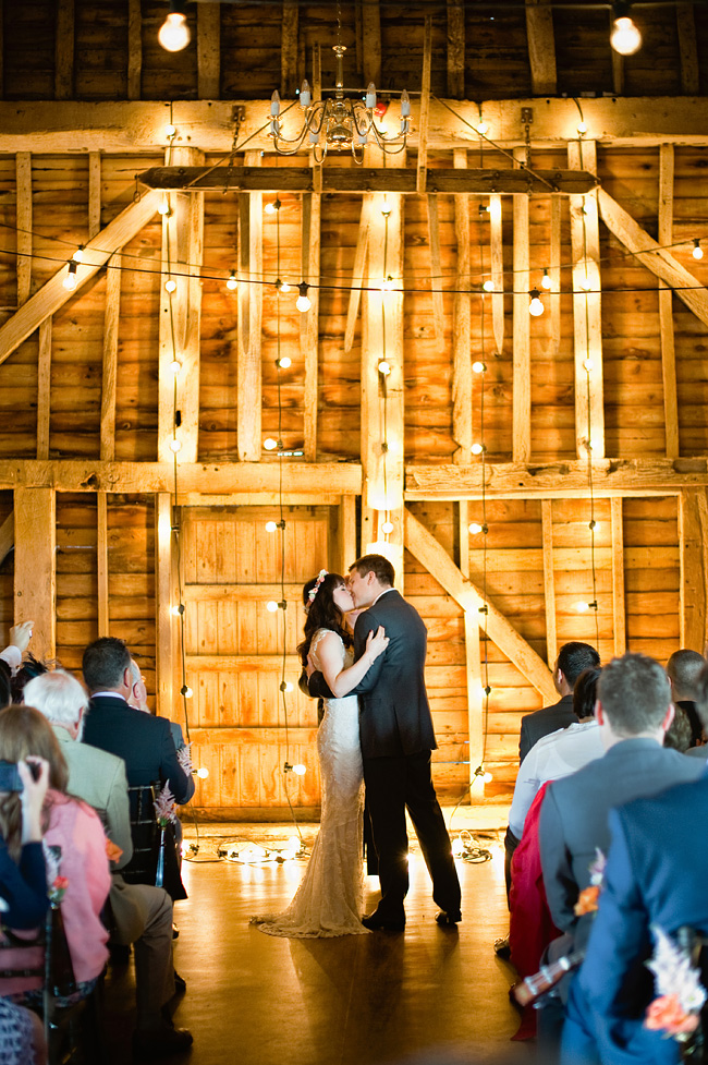 Sama and Paul on their wedding day at The Great Barn