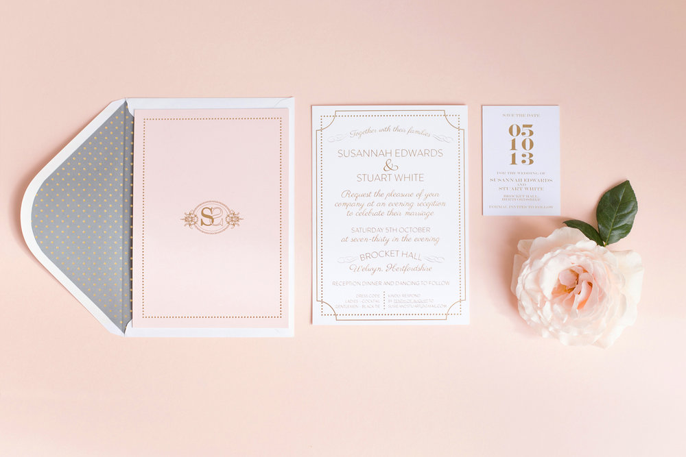Susannah and Stuart's gold foiled wedding invitations for their celebration at Brocket Hall