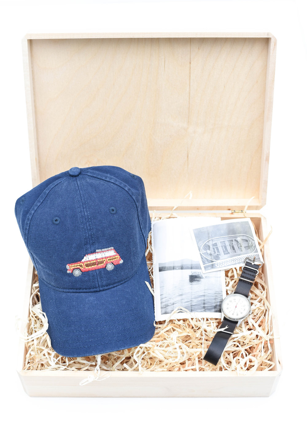 Gift Set For Him - For the Dad, the traveler, brother, uncle, friend, this simple set is perfect for the men on your list!  A baseball hat ready to be worn in, a classic watch, and printed pictures of favorite people and memories are sure to make an impression on the guys on your list.  For purchase info, click links below:L:R  | Needlepoint Baseball Hat  |  Wood Block With 12 Prints (not pictured, but a favorite of ours for just $20!) | Timex Weekender with Two Interchangeable Bands (item pictured older version)Our go to gift wrap this holiday, shown here:Unfinished Walnut Box (2 pack) | Aspen Wood Excelsior (BULK)Only needing to wrap one present?Individual Unfinished Walnut Box | Aspen Wood Excelsior (4 oz bag)