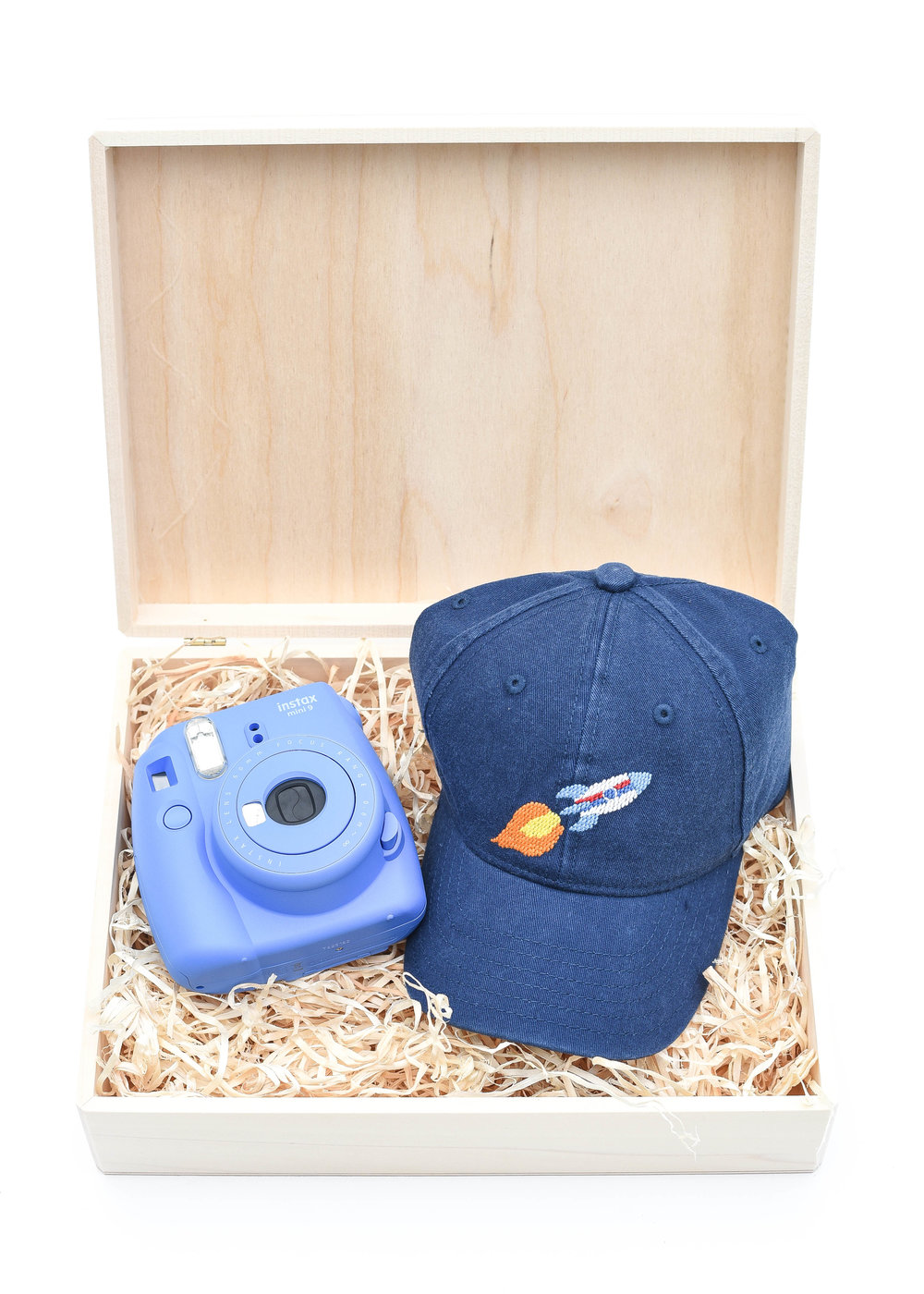 Gift Set For Boys - My favorite thing to gift my kids, is the opportunity of exploring and make-believe.  And what better way to encourage this than with a hat that needs to be worn in, and an instant camera to document all the adventures!  And don't think for a minute this is just for the boys, the girls on your list will love it too!  Camera and hat can easily be customized to a different color or style!  For purchase info, click links below:L:R  | Instax Mini 9 Instant Camera | Kid's Needlepoint HatOur go to gift wrap this holiday, shown here:Unfinished Walnut Box (2 pack) | Aspen Wood Excelsior (BULK)Only needing to wrap one present?Individual Unfinished Walnut Box | Aspen Wood Excelsior (4 oz bag)
