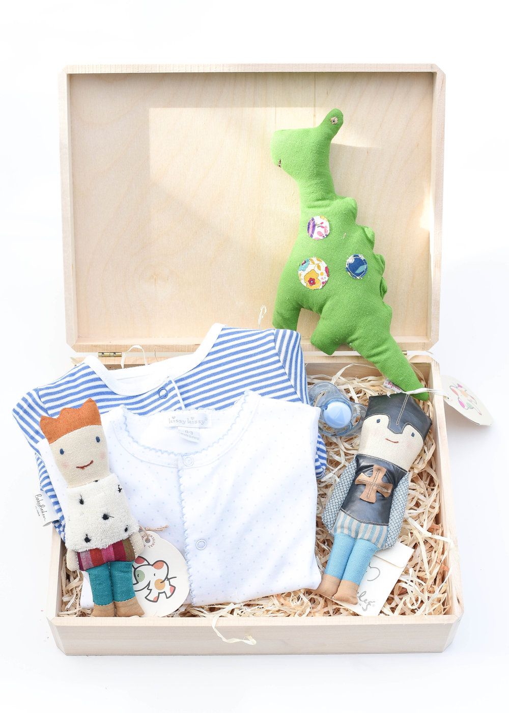Playful Baby Gift Set - This curated set is the perfect mix of comfort and fun!  Versatile, quality pieces keep baby cozy while on the move, and these rattles are ones that will keep baby entertained for years to come, but act fast, as these rattles are discontinued and on final sale!  To purchase, click links below:L:R    Prince Rattle   Reversible Stripe Cardigan   Pima Cotton Footed Playsuit   Dragon Rattle   Pacifier   Knight Rattle (can still be found here)  My go-to gift wrap this holiday, shown here:Unfinished Walnut Box (2 pack)   Aspen Wood Excelsior (BULK)Only needing to wrap one present?Individual Unfinished Walnut Box   Aspen Wood Excelsior (4 oz bag)
