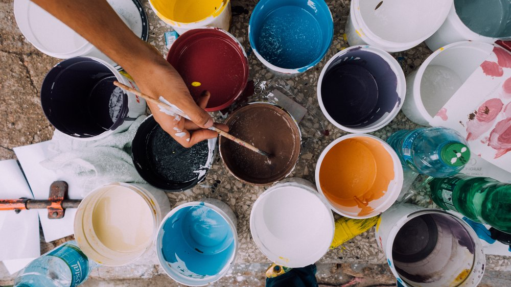 Paint In Buckets With A Paintbrush