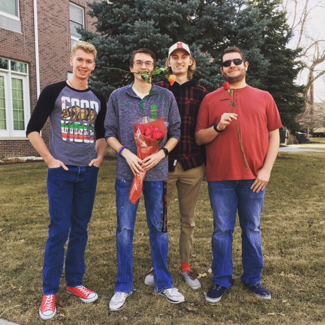 Men giving roses to sororities on Valentine's Day