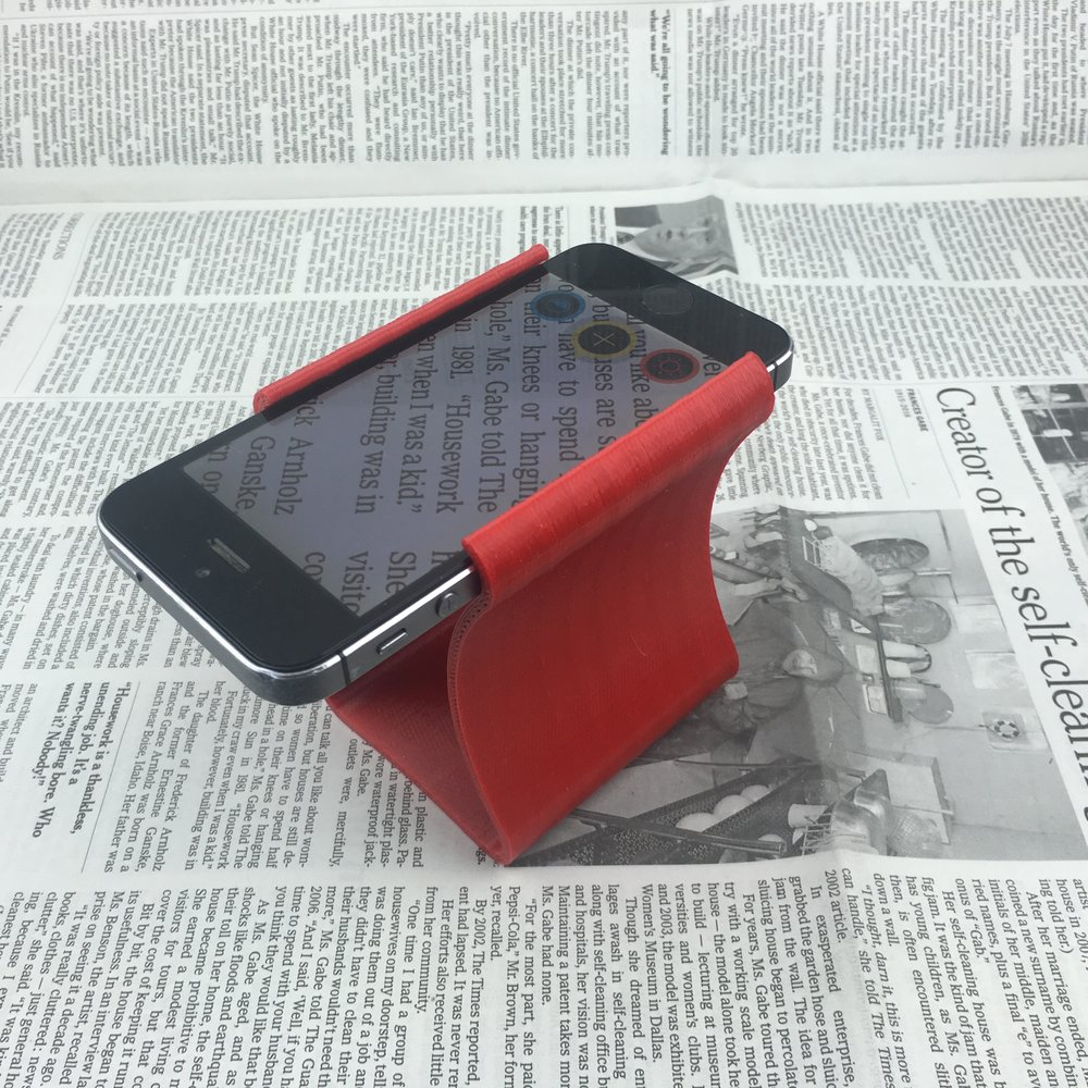 Red visor smartphone stand for people with low vision